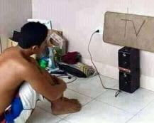 The poor man watch a flat-screen TV